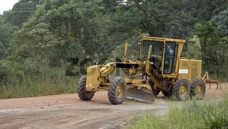 Roadworks machine in Brasil working on gravel road.