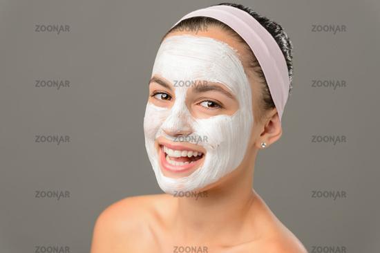 Smiling teenage girl face mask bare shoulders