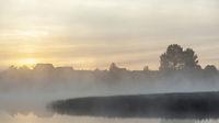 River before sunrise in the fog
