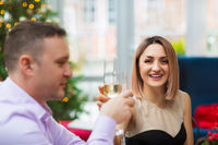 Cheerful couple during festive Christmas dinner