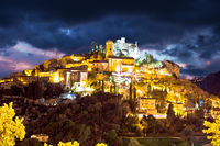 Historic village of Eze on stone cliff above Cote d Azur dramatic sky view