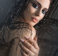Pretty brunette in shower - her hair loose and wet