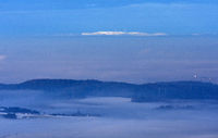 Distant view from the Swabian Alb to the Hornisgrinde in the fog-shrouded