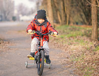 Child boy riding bicycle in the park