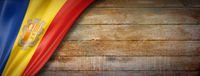 Andorran flag on vintage wood wall banner