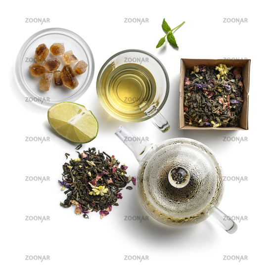Green tea with natural aromatic additives and accessories. Top view on white background