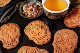 Halloween ginger cookies in the shape of skulls, homemade Dia de los muertos biscuits
