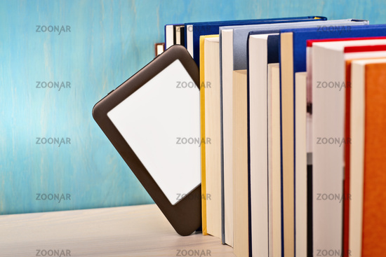 E-book reader between printed books