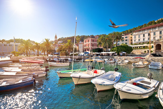 Turquoise waterfront and harbor of old town of Hvar sun haze view
