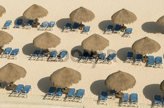 Beach umbrella of armchairs in the sand of Cancun