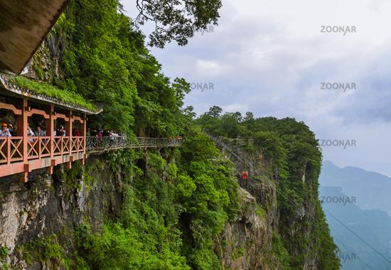 Zhangjiajie, China - May 25, 2018: Tourists on pathway in Tianmenshan nature park
