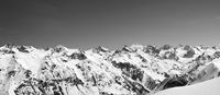 Panorama of snow covered mountains in winter