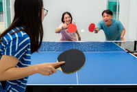 Asian family fun playing table tennis stay at home