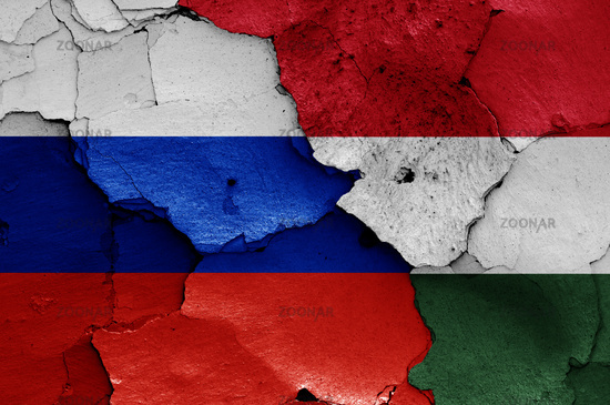 flags of Russia and Hungary painted on cracked wall