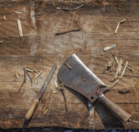 Hatchet and Rasp on Wooden Desk square