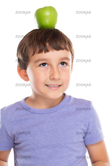 Young boy child with an apple fruit on his head healthy eating isolated on white