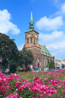 Beautiful church in Gdansk and beautiful. Urban nature. Nature in city. Flowers grow in city near ch