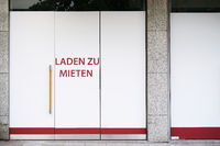 German vacancy sign on storefront - Laden zu mieten means store to let