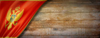 Montenegro flag on vintage wood wall banner