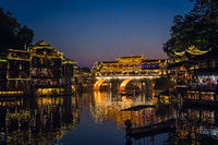 Illuminated historic arched bridge in Feng Huang