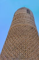 The Emin Minaret made made with textured bricks that are carved into geometric and floral mosaic pat