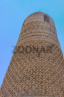 The Emin Minaret made made with textured bricks that are carved into geometric and floral mosaic patterns