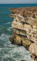 beautiful rugged coastline with waves crashing against the cliffs