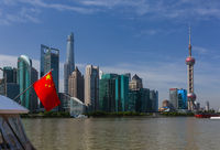 Shanghai, China - May 23, 2018: Chinese flag and modern Pudong skyline in Shanghai, China