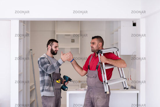 workers giving high five to each other