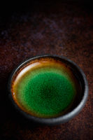 Handmade brown and green glaze rustic pottery bowl