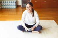 Young woman playing video game at home