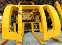 Vintage obsolete agricultural harvesting machine in bright yellow