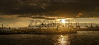 Panorama of the harbor of Hamburg (Süderelbe) with Köhlbrand bridge at sunset