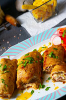 Vegetable roulade from roast  pork loins with salads