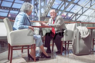 Elderly couple of travelers