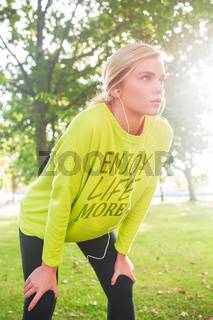 Composite image of active serious blonde catching her breath