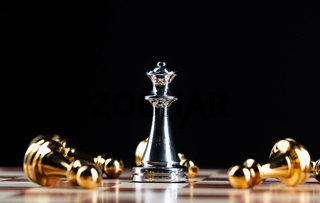 Silver queen chess defeats gold pawns on board.