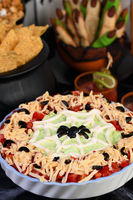 Spooky Halloween Seven Layer Taco Dip Turn a classic appetizer into a Halloween favorite with just a