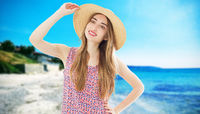 summer holidays and vacation concept - girl standing on the beach