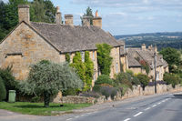 Row of traditional houses in Cotswold village of Bourton on the Hill