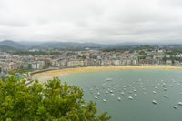 Tourism, view of the city of San Sebastian, with La Concha beach, from Mount Urgull. Summer vacation scene in Spain