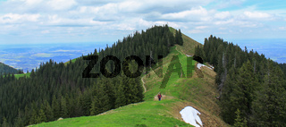 Panorama of Mount Vorderes Hörnle, 1484 m with Summit Cross and Hikers in Ammergauer Alps, in Bad Kohlgrub, Upper Bavaria, Germany