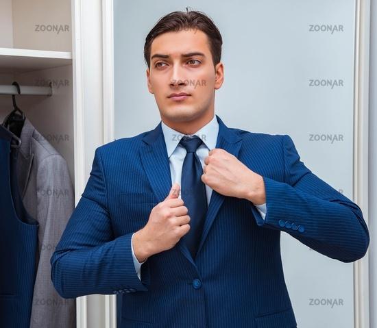 Businessman dressing up for work