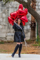 Lovely Hispanic Brunette Model Celebrates Valentines Day With A Dozen Red Heart Balloons