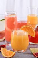 Refreshing freshly squeezed orange juice among fresh detox citrus juices from Sicilian orange, grape