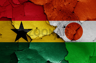 flags of Ghana and Niger painted on cracked wall