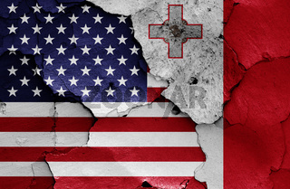 flags of USA and Malta painted on cracked wall