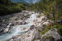 Clear fresh mountain river in alpine forest landscape, Mieming, Tirol, Austria