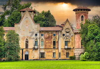 Miradolo castle, gothic design full of mystery, with sunset light.