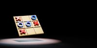 Tic-Tac-Toe Game Board Spotlighted on Black Background